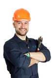 Builder with spanner isolated on white background. Young worker standing with spanner isolated on white background Royalty Free Stock Photography
