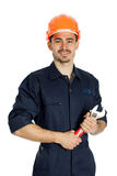 Builder with spanner isolated on white background. Young worker standing with spanner isolated on white background Royalty Free Stock Images