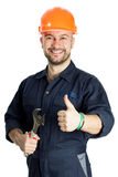Builder with spanner isolated on white background. Young worker standing with spanner isolated on white background Royalty Free Stock Image