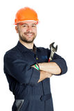 Builder with spanner isolated on white background. Young worker standing with spanner isolated on white background Stock Images