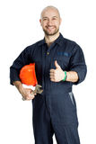 Builder with spanner isolated on white background. Young worker standing with spanner isolated on white background Stock Image