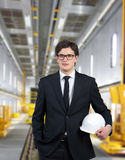 Builder standing on factory Royalty Free Stock Image