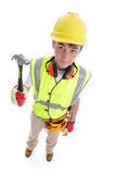 Builder standing with hammer Stock Image