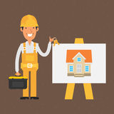 Builder stands near flip-chart and holds keys Stock Images