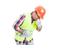 Builder with stomach problem is about to vomit. As nausea and sickness concept isolated on white background Stock Image