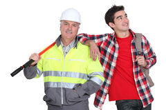 Builder stood with new employee. Builder stood with his new employee Royalty Free Stock Images