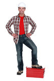 Builder stood on toolbox Stock Images