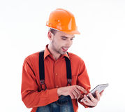 A builder with a tablet Stock Image