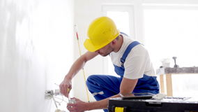 Builder with tablet pc and equipment indoors stock footage