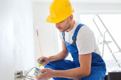 Builder with tablet pc and equipment indoors Stock Photo