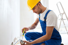 Builder with tablet pc and equipment indoors Royalty Free Stock Images