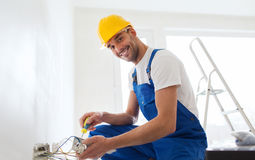 Builder with tablet pc and equipment indoors Royalty Free Stock Photo