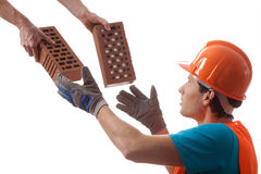Builder taking bricks Royalty Free Stock Image