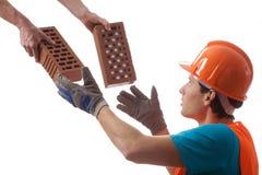 Builder taking bricks Royalty Free Stock Image