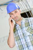 Builder taking important call Royalty Free Stock Photos