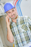 Builder taking important call Stock Photos