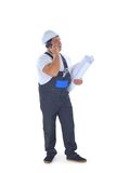 Builder talking on mobile phone Stock Image