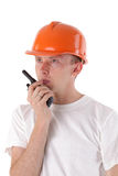 Builder talking on portable UHF radio transceiver Stock Photo