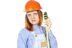Builder with a tape measure and helmet Royalty Free Stock Image