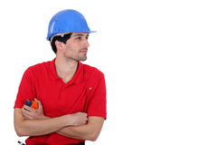 Builder with a tape measure Stock Image