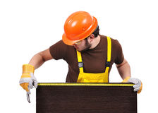 Builder with tape measure Royalty Free Stock Images