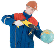 Builder, terrestrial globe and perforator Stock Photos