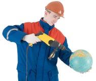 Builder, terrestrial globe and perforator Stock Photos