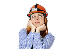 Builder thinks the girl in a helmet royalty free stock image