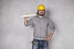 Builder is thriving on a gray background Royalty Free Stock Photo