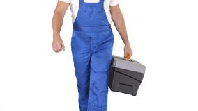 Builder with tool case walking on white background. Close up. Builder with tool case walking on white background. Professional shot in 4K resolution. 014. You stock video footage