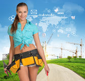 Builder in toolbelt. Green hills, road, tower Royalty Free Stock Photo