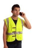 Builder tradesman takes a call Stock Photos