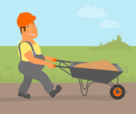 Builder with trolley is going to the project Royalty Free Stock Photography