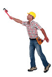 Builder trying to reach something. Royalty Free Stock Photography