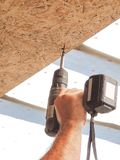 Builder twists the in the OSB sheet on the ceiling stock photos