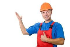 Builder in uniform pointing up Royalty Free Stock Images