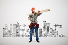 Builder in uniform showing thumbs up Stock Photography