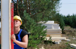 Builder using a builders level Stock Photo