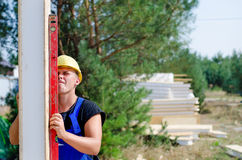 Builder using a builders level Stock Photography