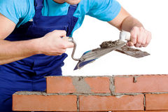 Builder using a cement and trowel Stock Images