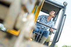 Builder using a crane. Man Royalty Free Stock Photos