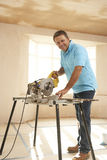 Builder Using Electric Saw Stock Photography