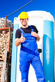 Builder using mobile toilet on site Stock Photography