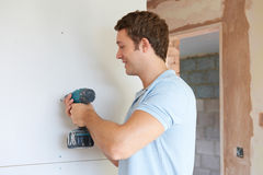 Builder Using Power Tool On Site. Builder Uses Power Tool On Site Stock Images