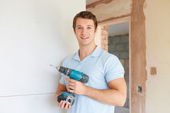 Builder Using Power Tool On Site. Builder Uses Power Tool On Site Royalty Free Stock Image