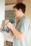 Builder Using Power Tool On Site. Builder Uses Power Tool On Site Stock Photos