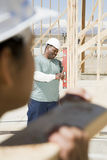 A builder using a spirit level Stock Images