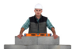 Builder using a spirit level Royalty Free Stock Images