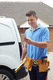 Builder With Van Checking Text Messages On Mobile Phone Outside stock images