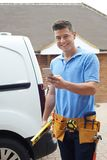 Builder With Van Checks Text Messages On Mobile Phone Outside Ho Royalty Free Stock Photo